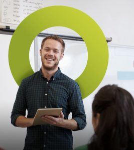 presenting-in-front-of-a-whiteboard-with-Earth-Green-with-circle